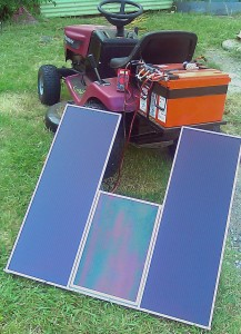 An array of solar panels, charging the 36 volt battery of a lawnmower